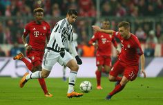 Alvaro Morata of Juventus and Joshua Kimmich of Bayern Muenchen compete for the ball during the UEFA Champions League round of 16, second Leg match between FC Bayern Muenchen and Juventus at the Allianz Arena on March 16, 2016 in Munich, Germany. (March 15, 2016 - Source: Alexander Hassenstein/Bongarts)
