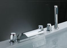Waterfall bathtub faucet with hand wand