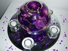 Cadbury purple centre piece - purple deco beads with artificial orchid.