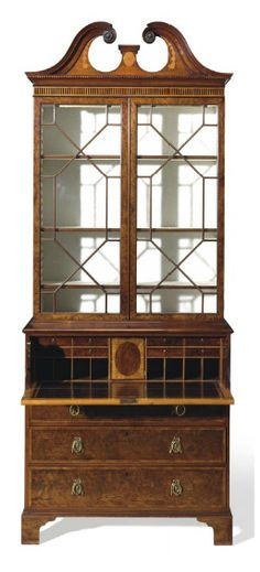 A GEORGE III YEWWOOD, MAHOGANY AND ENGRAVED MARQUETRY SECRETAIRE-BOOKCASE ATTIBUTED TO MAYHEW AND INCE, CIRCA 1775