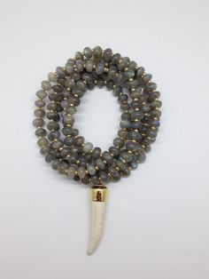 Labradorite and Bone Horn Pendant Necklace by Goldenstrand Jewelry