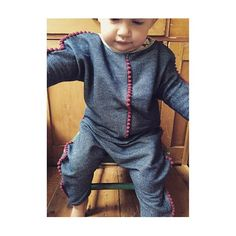 Getting this one to stay still today for a proper photo is impossible but here's the denim style cotton Jersey version of the Om lounge suit with berry Pom-Poms. Both styles will be available to order from the site soon. #om #ombaby #harems #handmade #baby #toddler #style #kidsfashion #loungewear #pompoms #denim #shopindependent #coolkids #madebymama #london