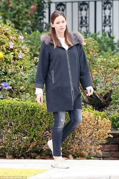 Stayin warm: The star covered up in a big blue zip-up coat with a fur trim on the hoodie. ...