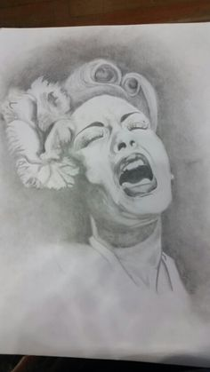 Graphite Billie Holiday drawing I did for class. Added hair and flower separate from original reference photo.