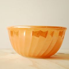 Vintage Fire King Bowl Copper Tint Peach Lustre Swirl Mixing Bowl. $12.50, via Etsy.