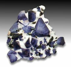 Benitoite Natrolite Matrix.  Benitoite is a rare mineral; first thought to be a sapphire, but under exam, it was named a new mineral. It was called benitoite after its location near the headwaters of the San Benito River in northern California, south of San Jose.