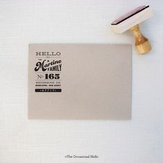 Woodcut return address stamp from the Occasional Hello.