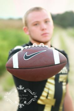 Senior Photography - Senior boy photography - Senior boy with football - football - photo by Amazing Grace Photography