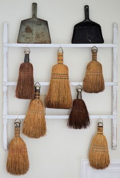 milliebelleblogspot.  Collection of vintage brooms and dustpans..
