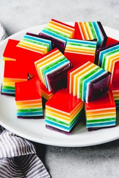 The jiggliest, most colorful and whimsical treat of all, this Layered Rainbow Jello is the perfect finger food for parties. This finger jello a total crowd-pleaser and it's fun and easy to make. Every time Rainbow Jello, Rainbow Desserts, Rainbow Treats, Jello Desserts, Rainbow Food, Jello Recipes, Dessert Recipes, Rainbow Art, Finger Food Desserts