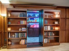 Project Type: Sliding Double Bookcase Wood Species: Alder Finish Type: Stained Additional Features: Fully motorized. Dual high strength magnetic locks.