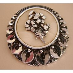 """Vintage silvertone scarf ring with Mother of Pearl centre with flower 1.5""""wide"""
