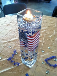 Military retirement centerpiece with flag and candle Military Decorations, Retirement Party Decorations, 4th Of July Decorations, Military Retirement Parties, Military Party, Retirement Ideas, Military Ball, Military Wedding, Retirement Celebration