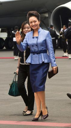 Peng Liyuan, wife of President Xi Jinping of China, is not only one of the most powerful women on China's political scene and in the world, but also a fashion force to be reckoned with. Favoring structured items and native Chinese designers, China's first lady was named to the International Best Dressed list in 2013.
