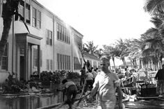 Rescue workers help evacuate the Lunalilo High School in Honolulu after the roof of the main building was hit by a bomb.