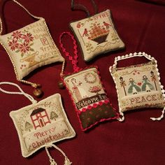 Finished some ornaments from the Sampler Tree series by Little House Needleworks.