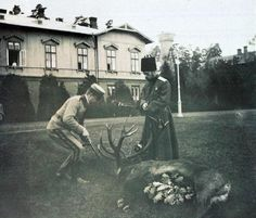 Nicholas II, Tsar of Russia with a stag at the Imperial Hunting Lodge in Poland, By courtesy of the Beineke Rare Book and Manuscript Library, Yale University