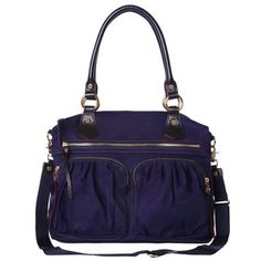 Modeled after the favorite Jane, the Belle is a large everyday bag fit for your work-to-gym routine, a day of classes, or a quick weekend getaway. With rolled Italian leather shoulder handles and an optional cross-body strap. For AW14, we crafted it in our signature Bedford Nylon in deep midnight blue. With custom MZ Wallace gold hardware and signature red edge-dye.