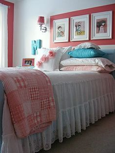 some things here i like. i LOVE the quilt. like the white and coral colors.(but not aqua)  like the color paint on the wall around the white frames...