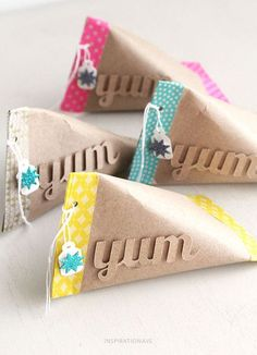 Empty toilet paper rolls, end stitched with washi tape or paper, add a tag!