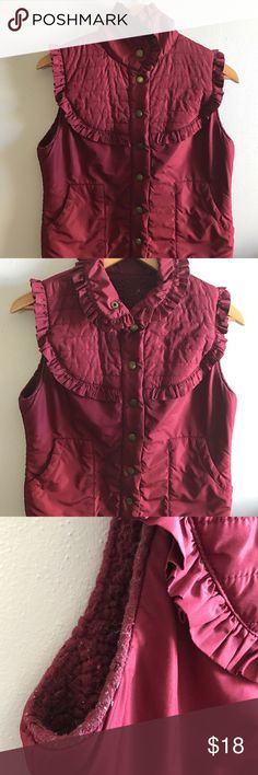 Merlot puffy vest The cutest vintage puffy vest in a wine color with a ruffled yolk, side pockets, and Sherpa style lining. I've had this for over 10 years and still in great condition but no longer fits my postpartum body wear it with yoga pants , high waisted jeans and even a plaid tweed skirt for a vintage alpine look. Super adorable . Jackets & Coats Puffers