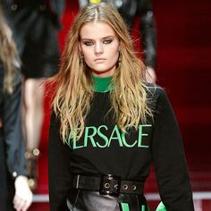 """As seen on the """"Zoe Report"""" the logo sweatshirts from the 90's are back and bolder than ever! Logo Mania was a huge trend that were seen on both men and women. Designer Versace as shown on the runway model in this photo is bringing back this logo sweatshirt trend march 13, 2015 as well as other designers like Louis Vuitton.   (K Covin)"""