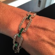 I loved trying on this beautiful 1925 diamond and emerald bracelet by Black, Starr & Frost. Photo by Justin Wisner. #blackstarrfrost #sothebysjewels #gatsbystyle #lifeofluxury #artdecojewelry #jewelrycrawl #roaringtwenties #daisybuchanan #emeralds