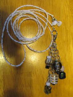 Simple seed bead lariat with exchangeable toggles. This one is metal and glass in black, grey and white. A Julz By Design original.