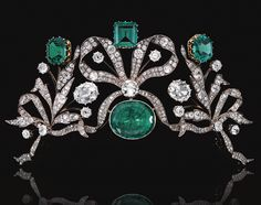 EMERALD AND DIAMOND TIARA, CIRCA 1870/  Designed as series of bows entwined with foliate sprays set with cushion-shaped and circular-cut diamonds, centring on an oval emerald surmounted by an octagonal emerald, a step-cut emerald and a hexagonal emerald, weighing respectively 7.58, 7.26 and 8.05 carats, accented to the centre with two oval diamonds weighing 2.93 and 3.85 carats respectively,  detachable tiara frame, the tiara can be worn as a devant de corsage and as a necklace centre