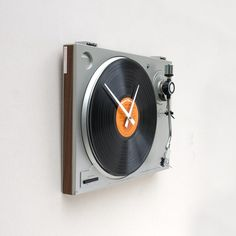 A clock made from recycled turn table- Pete would love this! Except he'd probably try to turn it back into a functional turntable....