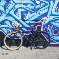 A Pure Fix bike with dropbars against an art wall. #bike #bicycle #fixie #fixedgear #art #streetart #graffiti