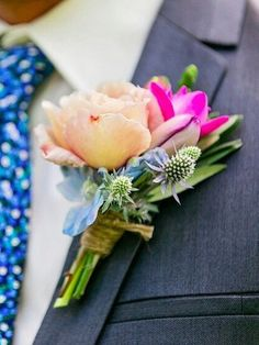 Colourful grooms buttonhole.