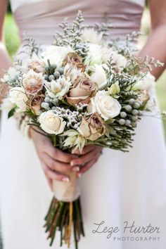 Best vintage bouquet I've seen. The earth tone colors hold up the integrity of the earthy wedding atmosphere, without overdoing it.