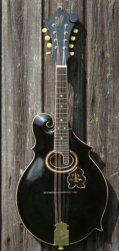 Gibson F2 Mandolin. I've played one of these and want one... badly :-) This is the original Gibson scroll mandolin, from the era when Orville Gibson still owned the company.