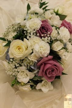 Lovely as can be with lavender roses, babies breath, carnations, hydrangea, and a touch of freesia.