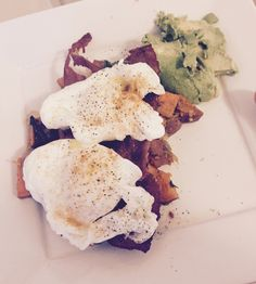 Sweet potatoes sautéed with spinach, garlic and onions. Turkey bacon with boiled eggs over and Avo on the side. Delilah
