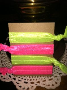 """FOE Hair Ties / Bracelets NEON by KeepItKrafty on Etsy, $1.50  No more headaches ladies! ave you heard about the new fold-over elastic, no snag, no crease hair ties? They are uber popular and """"in"""" this year, and even Celebrities have been sporting them. Don't buy retail prices from big companies, buy from the little people (crafters) of Etsy! I just placed an order for 2 sets HERE, the owner is super sweet and helpful! NOW GO BUY! Quick, like a bunny LOL  Click photo to go to the shop."""