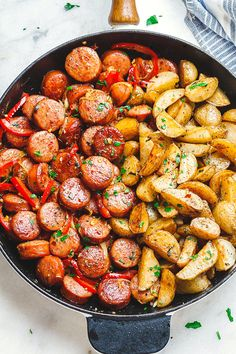 Smoked Sausage and Potato Skillet - Sizzle up a skillet full of delicious goodness with smoked sausage, potatoes, and bell peppers!