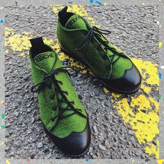 A pair of exclusive low-top sneakers handcrafted from natural wool felt and genuine leather. This model is made from green wool felt with black genuine leather