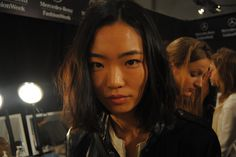 Backstage at New York Fashion Week. Here's Li before makeup.
