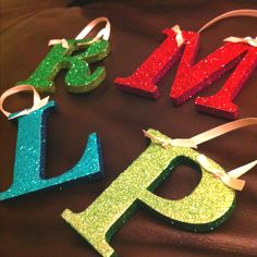 Initial ornaments I made for our first Christmas as a family of 4! .99 chip board letters from hobby lobby and glitter with contrasting edges.