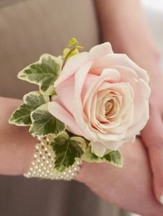 A fresh rose corsage, worn on the wrist, looks wonderfully elegant and adds an air of vintage chic. This corsage can be chosen to compliment any bridal outfit, whtether it's the bride, bridesmaids or a special wedding guest.  http://www.interflora.co.uk/catalog/product.xml?product_id=2524336;=1