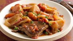 Throw together round steak, potatoes, carrots, onions and tomatoes before you go to work.  It'll be ready to enjoy when you get home.