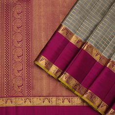 This classic kanjivaram sari in cream shot with black is handwoven with checks in gold zari running along the body. The border in pink shot with black has peacock, temple and geometric patterns in gold zari, along with a selvedge in mustard yellow. Kanakavalli Sarees, Kanjivaram Sarees Silk, Mysore Silk Saree, Party Sarees, Kanchipuram Saree, Saris, South Indian Sarees, Indian Silk Sarees, Art Silk Sarees