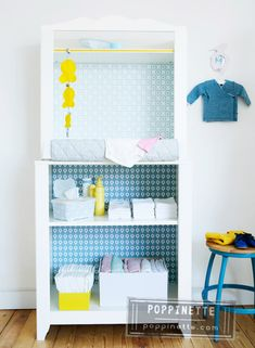 14 IKEA hacks for babies nursery: Transform a bookcase into a nifty change table for the nursery by adding wallpaper and a few handy storage baskets.   Mum's Grapevine