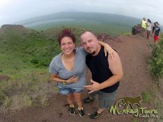 Couple posing at a beautiful view point from the Masaya Volcano National Park in Nicaragua.... See more at: https://costaricamonkeytours.com/nicaragua-costa-rica-tour/