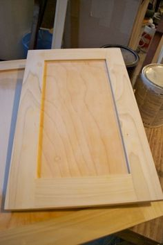 Adding Flat Trim To Existing Cabinet Doors, Black Lower, White Upper