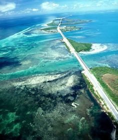 US 1, Florida Keys: Leaving the mainland for the 120-mile-long island chain of Florida's Key Islands, travelers enter a paradise of beach bars, water sports, and Parrotheads. From Key Largo to Key West, the overseas highway strings the islands together like beads, running past lighthouses, underwater coral-reef parks, and across 7 Mile Bridge - one of the longest bridges in the world. www.travelandleis...