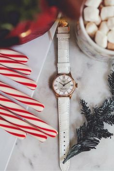 The Tissot Chemin Des Tourelles Powermatic 80 Ladies watch, gold with white leather strap, brings charm and sophistication to any outfit. Watches Photography, Jewelry Photography, Xmas Photos, Holiday Mood, Flat Lay Photography, Christmas Photography, Holiday Jewelry, Luxury Watches For Men, Christmas Wallpaper