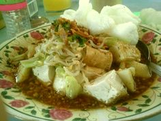 Kupat tahu magelang.. you should try, very cheap!